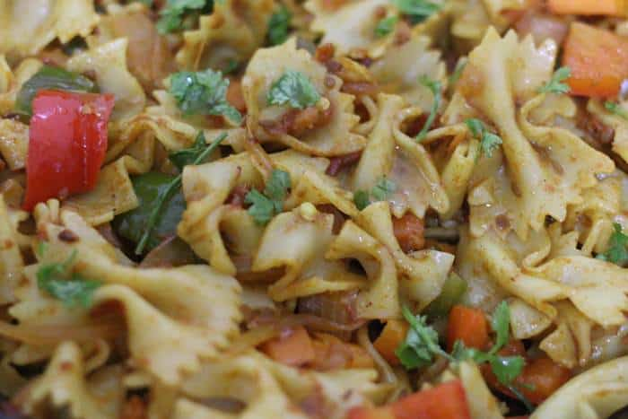 cilantro leaves and lemon juice added to Indian pasta