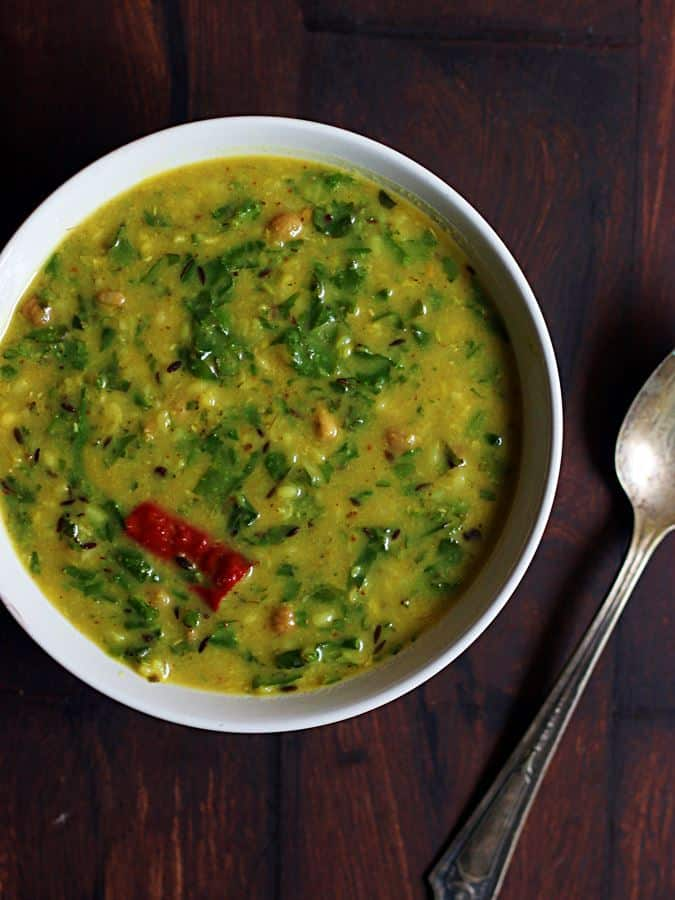 Freshly prepared palak dal served in a white bowl with a spoon for lunch