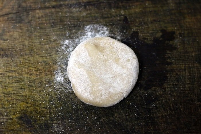 dough ball slightly flattened and dusted in dry flour.