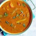 delicious homemade sambar served in a enamel pan