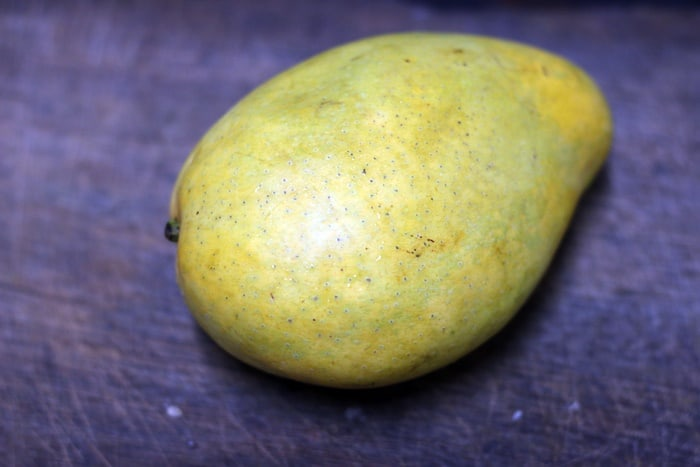fresh ripe mango ready to be cut