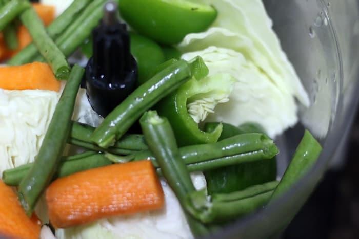 Mixed veggies in a food processor bowl