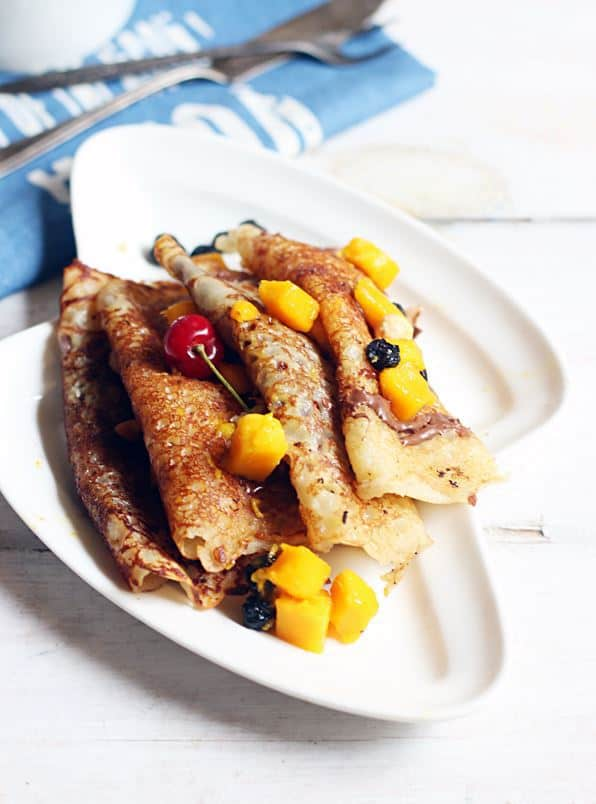 eggless crepes recipe-a plate containing sweet dessert egg free crepes