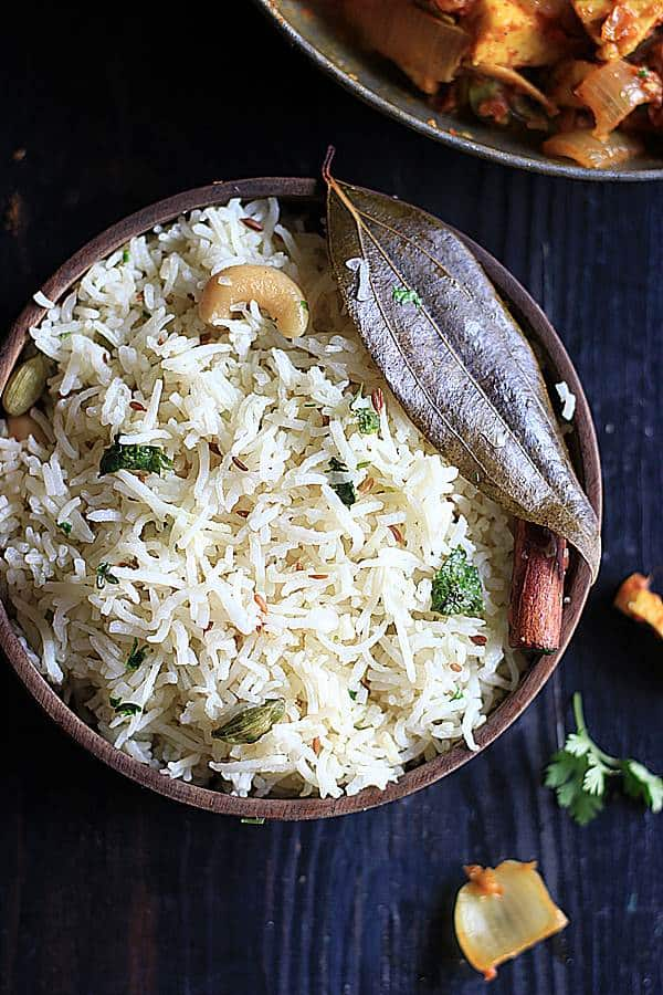 best easy jeera rice served in a wooden bowl- Closeup shot