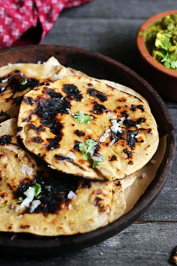 smoky charred tandoori rois served in a wooden plate.