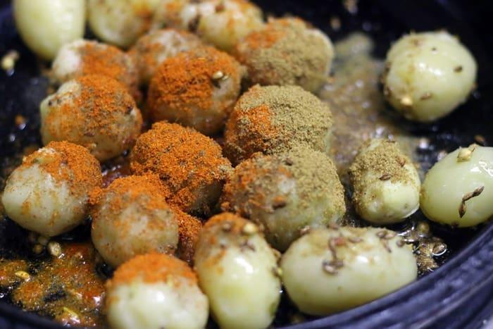 making bombay potato curry