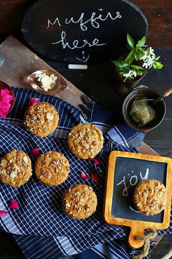 carrot muffins served for breakfast with a chalkboard handwritten menu