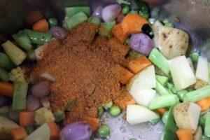 bisi bele bath powder added to sautéed vegetables.