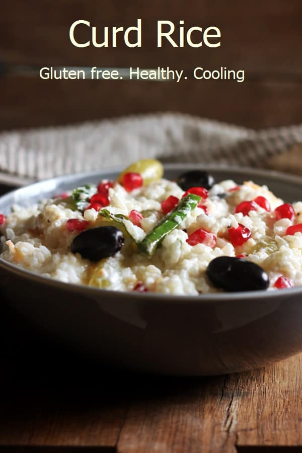 Curd rice garnished with fruits served in a ceramic bowl