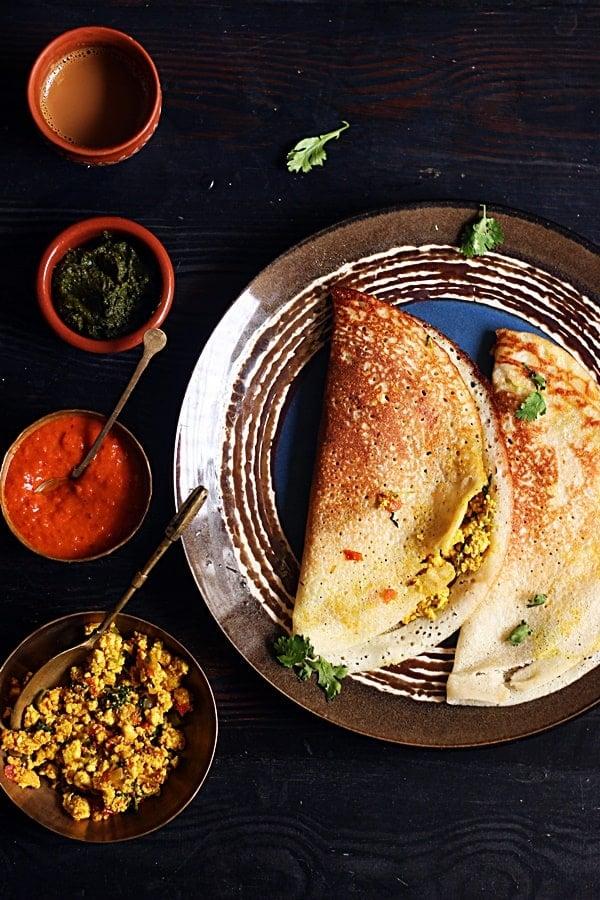 Paneer masala dosa served with chutney, sambar and coffee