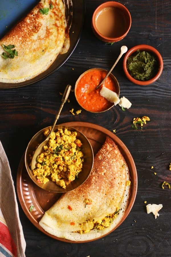 Paneer dosa served with coffee in a copper plate