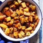 Potato roast served in a blue enamel pan- ready to eat