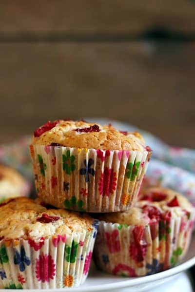 Stack of egg free strawberry muffins on a white plate served for snacks