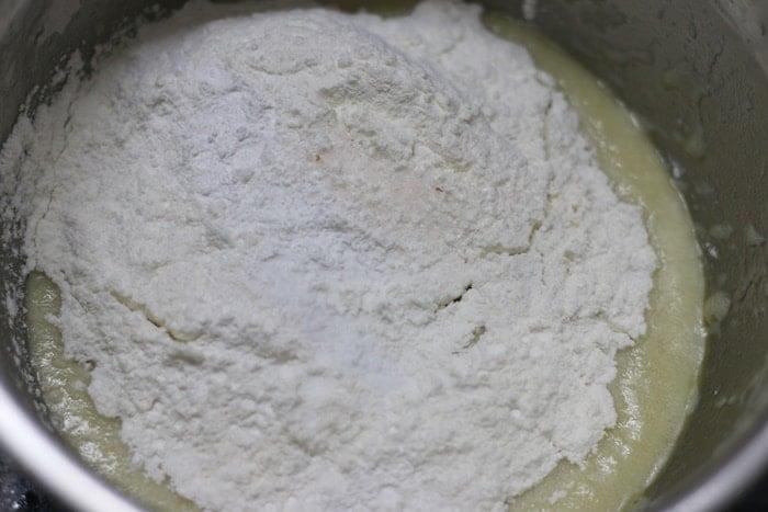 Sifting dry ingredients into wet ingredients.