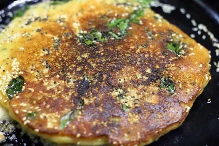 cooking handvo in a pan