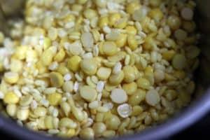 lentils and rice in a blender jar for making handvo recipe