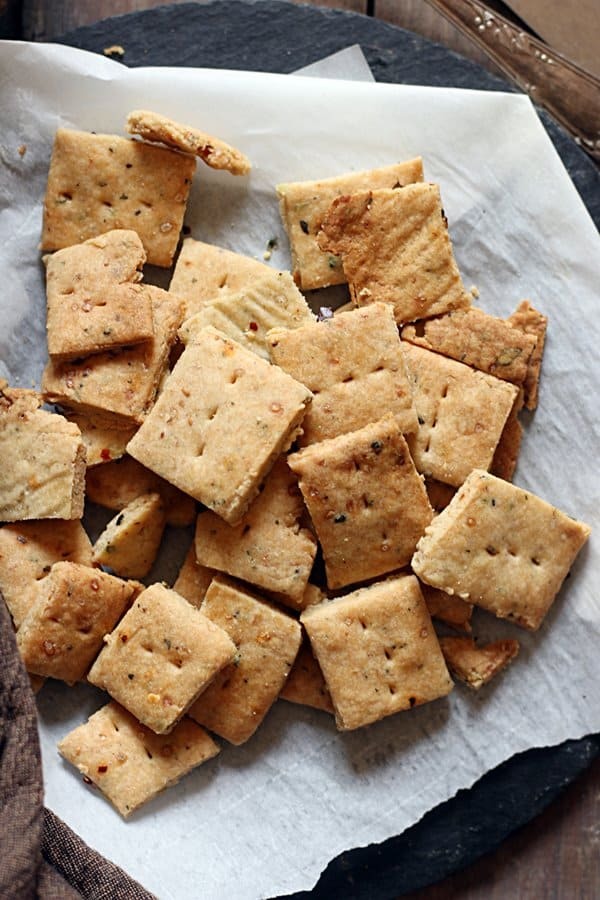Freshly baked pizza crackers served as snack with tea