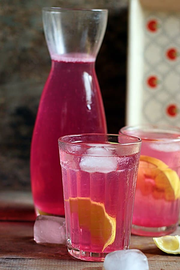 Chilled rose lemonade served with lemon slices