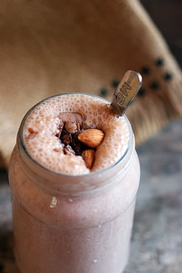 Closeup shot of thick sharjah shake served in glass bottle