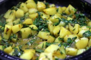Making aloo palak curry