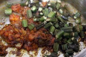 fried bhindi added to prepared onion tomato masala