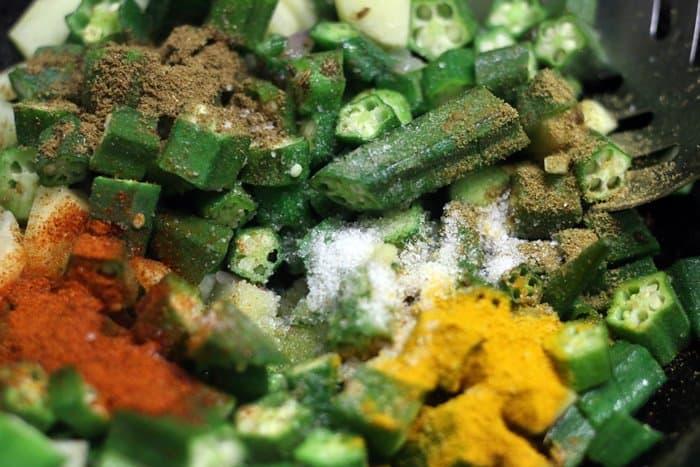 adding spice powders for okra rice