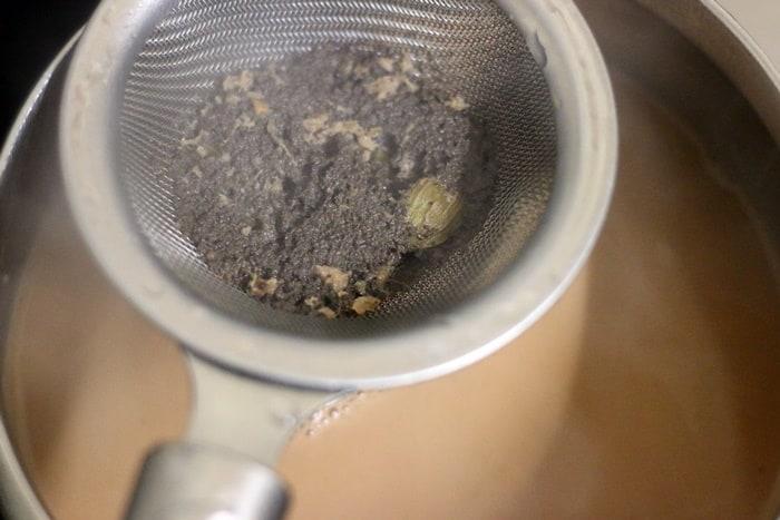 straining tandoori chai