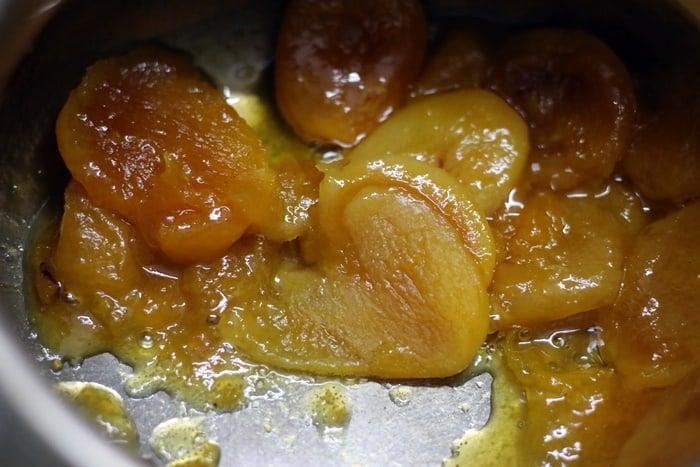 preparing khubani ka meetha dessert