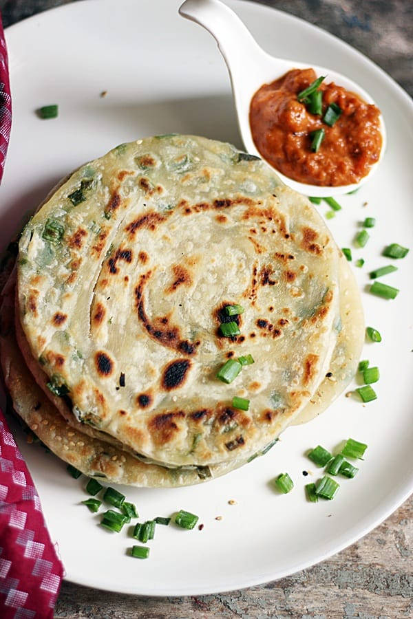 overhead shot of scallion pancakes with dipping sauce