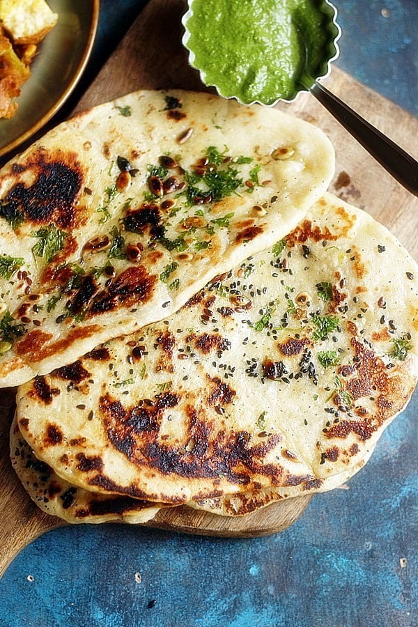 overhead shot of vegan naan topped with sesame seeds