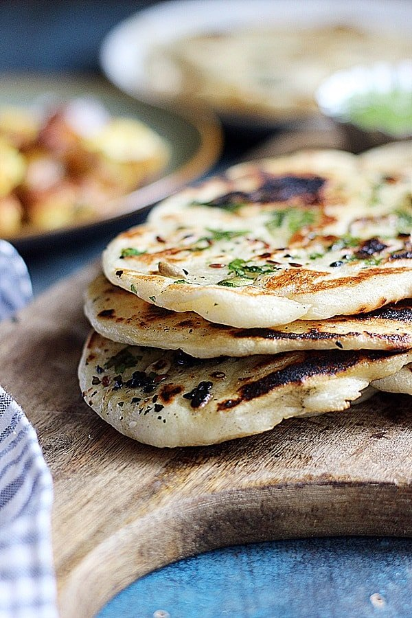 closeup shot of soft fluffy vegan naan breads stacked