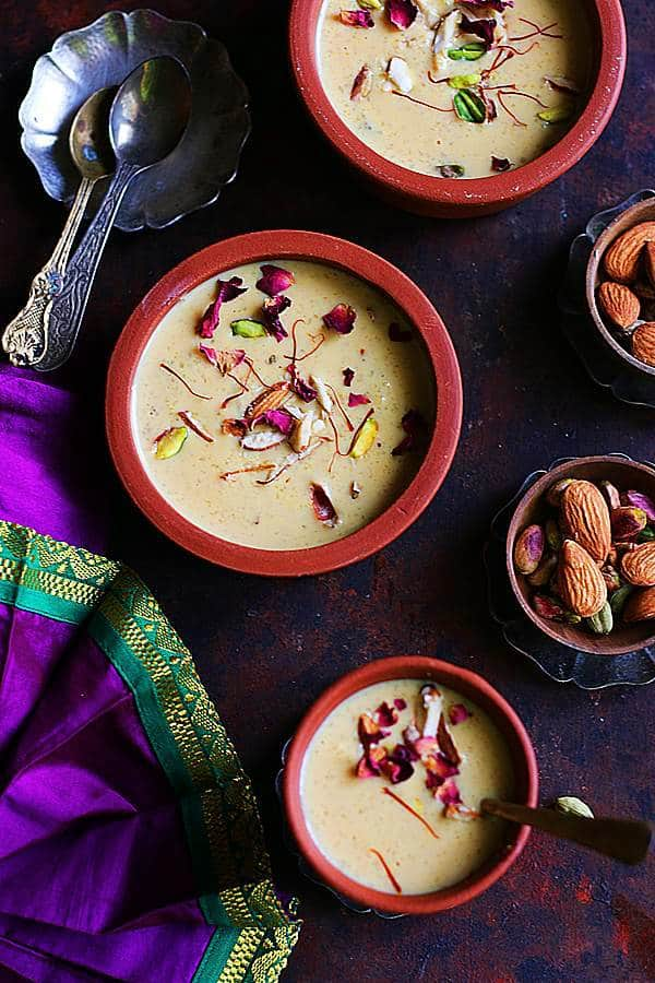 slow cooked traditional phirni served in small earthern ware pots.