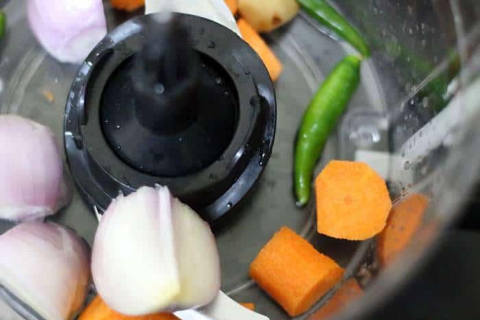 vegetables added to food processor jar