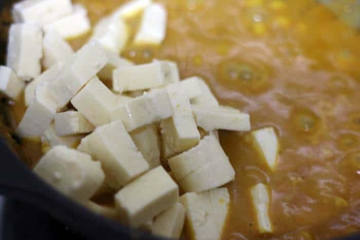tofu added to curry sauce