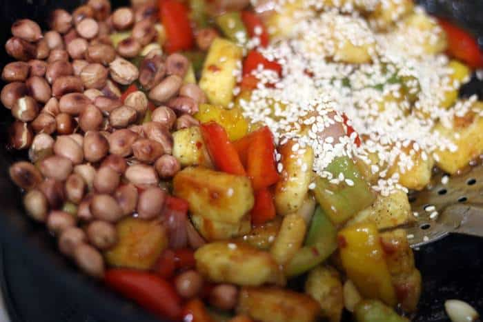 peanuts and sesame seeds added to kung pao tofu