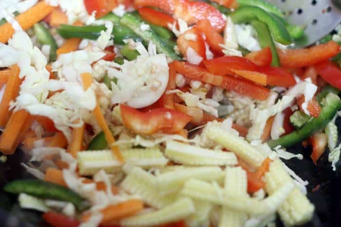 sauteing sliced vegetables in sesame oil
