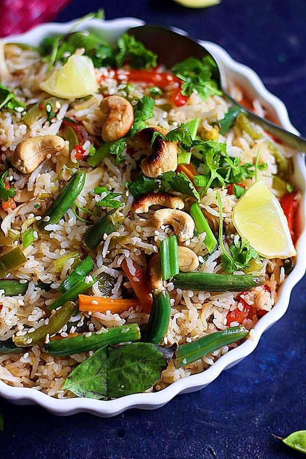 Thai fried rice topped with roasted cashews