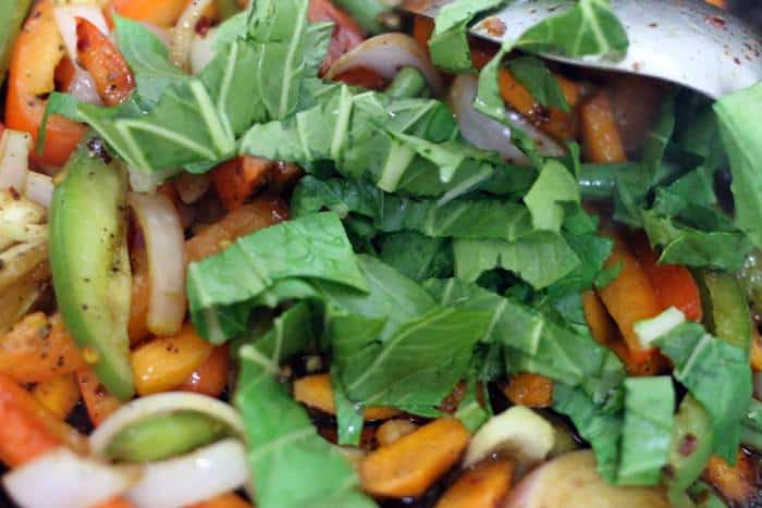 bok choy greens added to sauteed vegetables