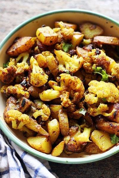 Punjabi aloo gobi sabzi dry served in a enamel bowl