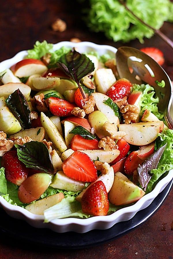 closeup shot of fresh apple strawberry walnut salad