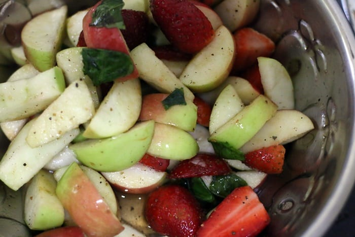 making salad with apple and walnuts