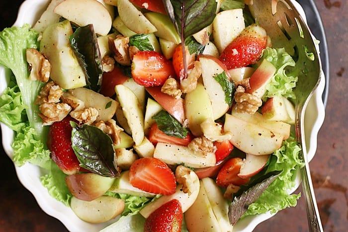walnut apple salad served over a lettuce bed.