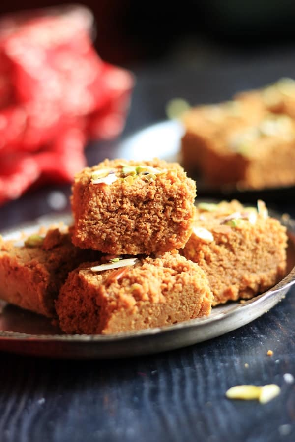 stack of delicious mohan thal- chickpea fudge in a silver plate