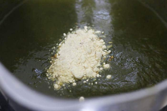 maize flour added to simmring saag