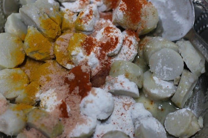 spice powders and rice flour added to chopped taro