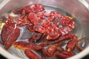 dried red chilies soaked in hot water for rehydrating
