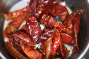 soaked and drained red chilies in a food processor jar for making harissa sauce recipe
