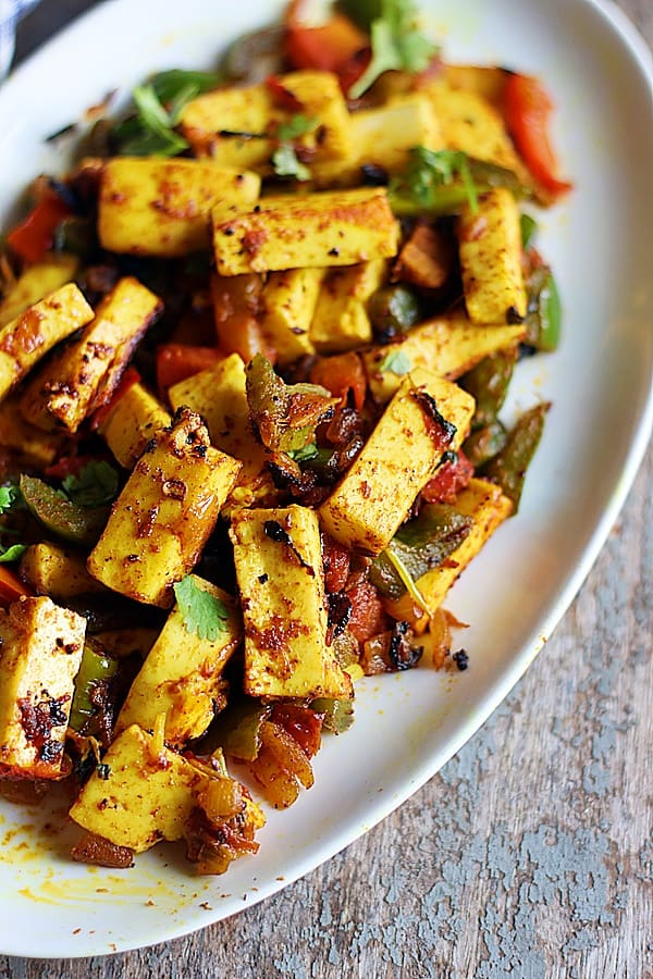 paneer khurchan served in a ceramic white plate