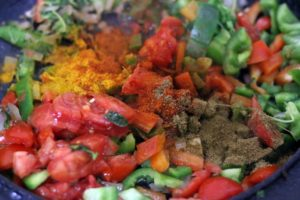 spice powders added to sautéed vegetables