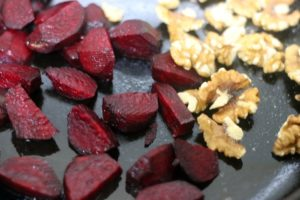 roasting beets and walnuts in a cast iron pan.